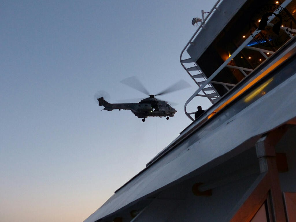 The helicopter hovers over the rear pool deck during its first attempt